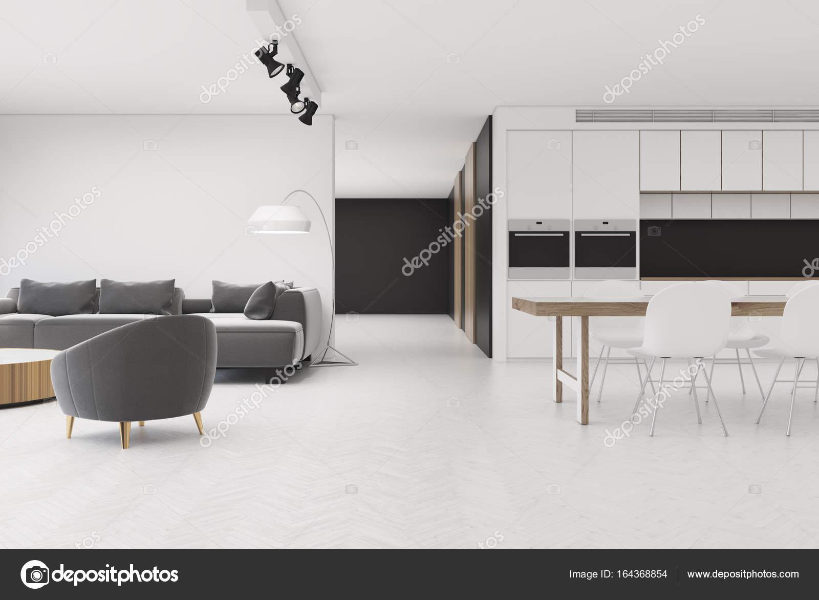 https://st3.depositphotos.com/2673929/16436/i/1600/depositphotos_164368854-stockafbeelding-wit-woonkamer-met-grijze-fauteuil.jpg