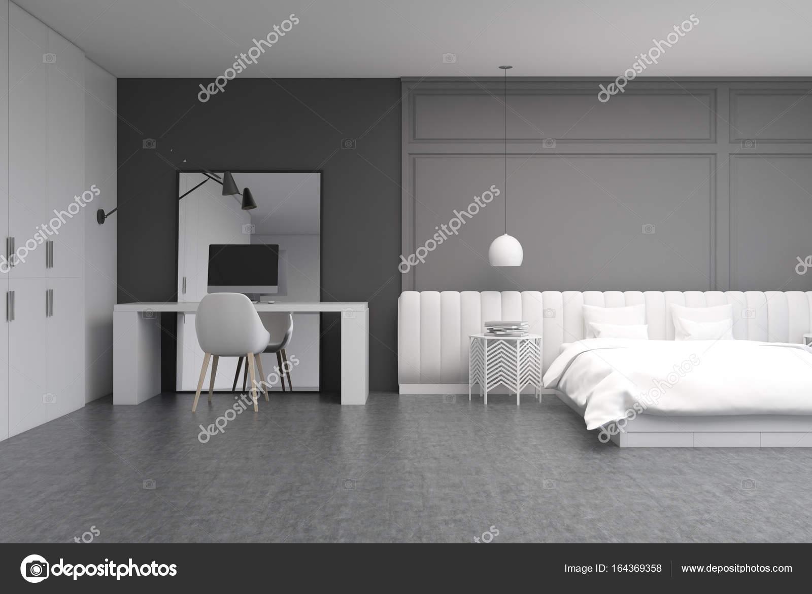 Chambre grise avec un bureau à domicile u photographie