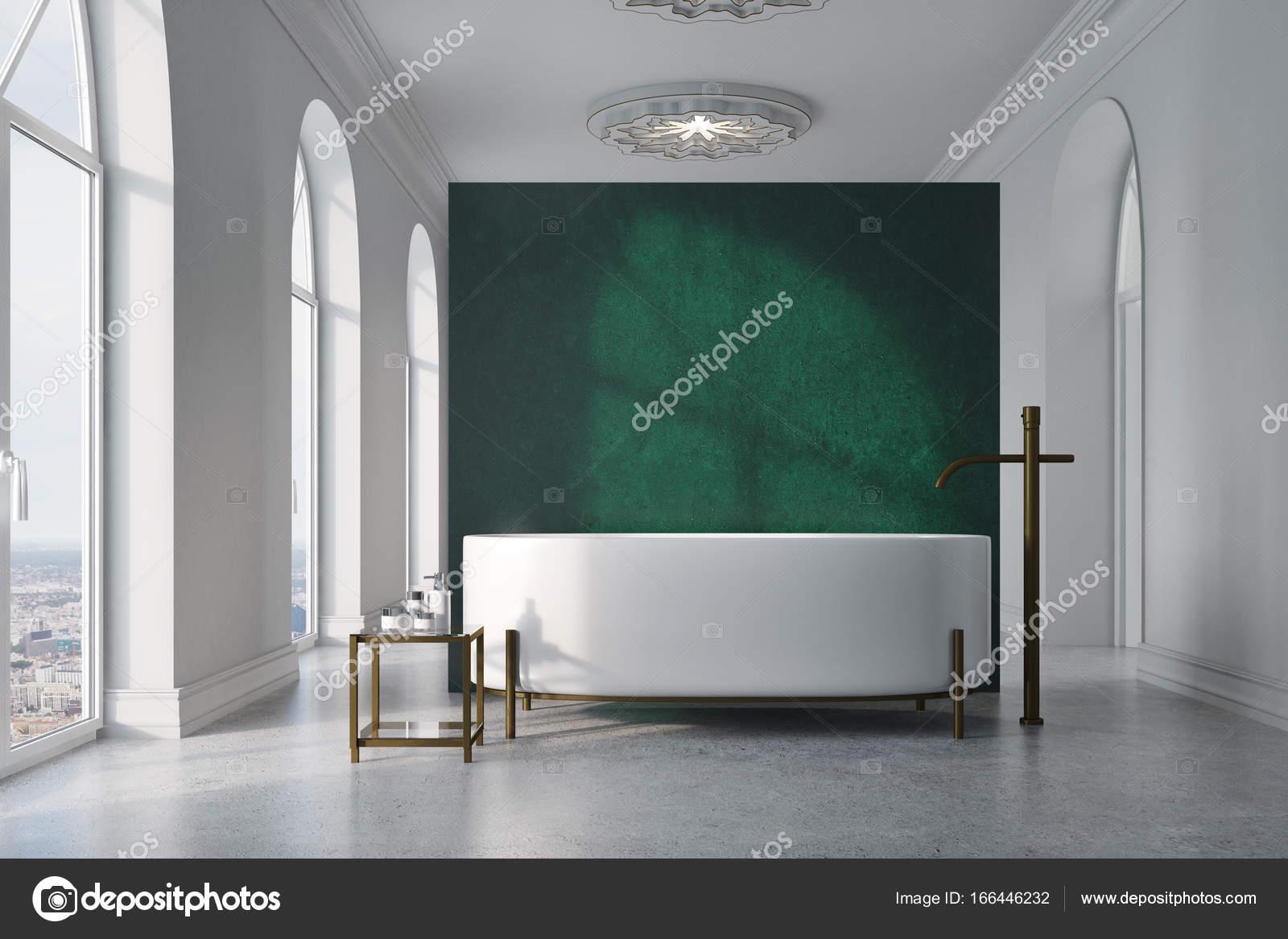 Intérieur De Salle De Bain Vert Et Blanc Avec Un Plancher De Béton,  Beaucoup De Fenestration, Une Baignoire Ronde Près Du0027un Mur Vert Et Une  Table Avec Des ...