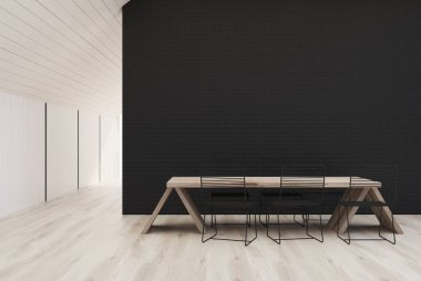 White and black kitchen with a wooden table