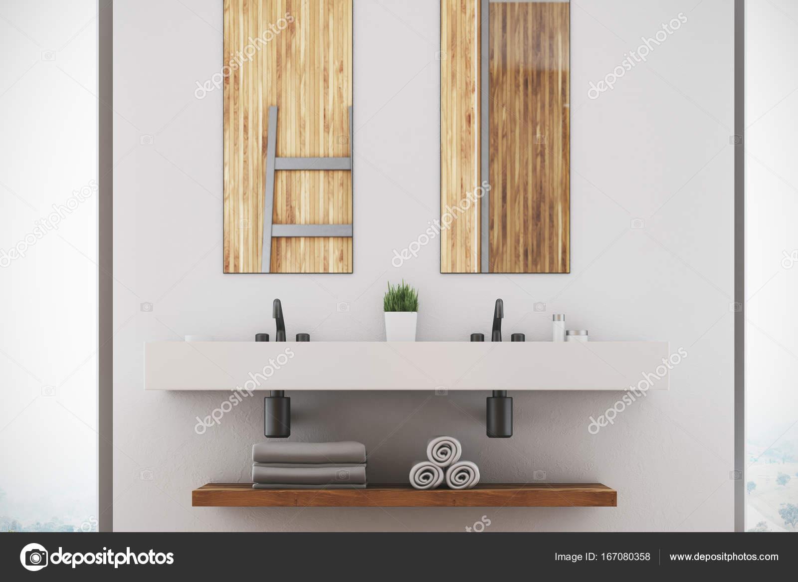 https://st3.depositphotos.com/2673929/16708/i/1600/depositphotos_167080358-stockafbeelding-witte-badkamer-dubbele-wastafel-spiegels.jpg