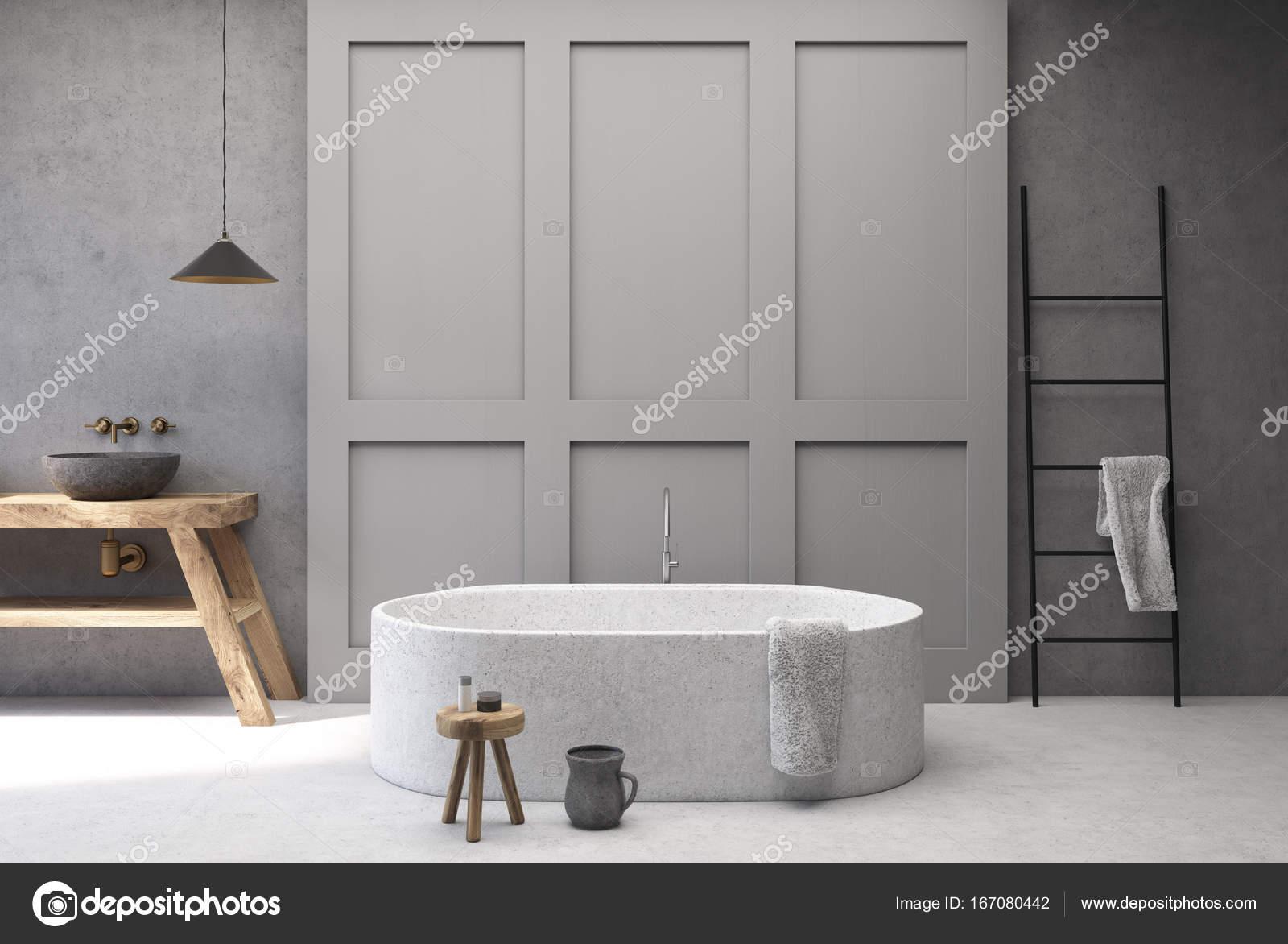 Salle de bains béton et gris, rond baignoire — Photographie ...