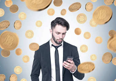 Bearded businessman looking at phone, bitcoin rain