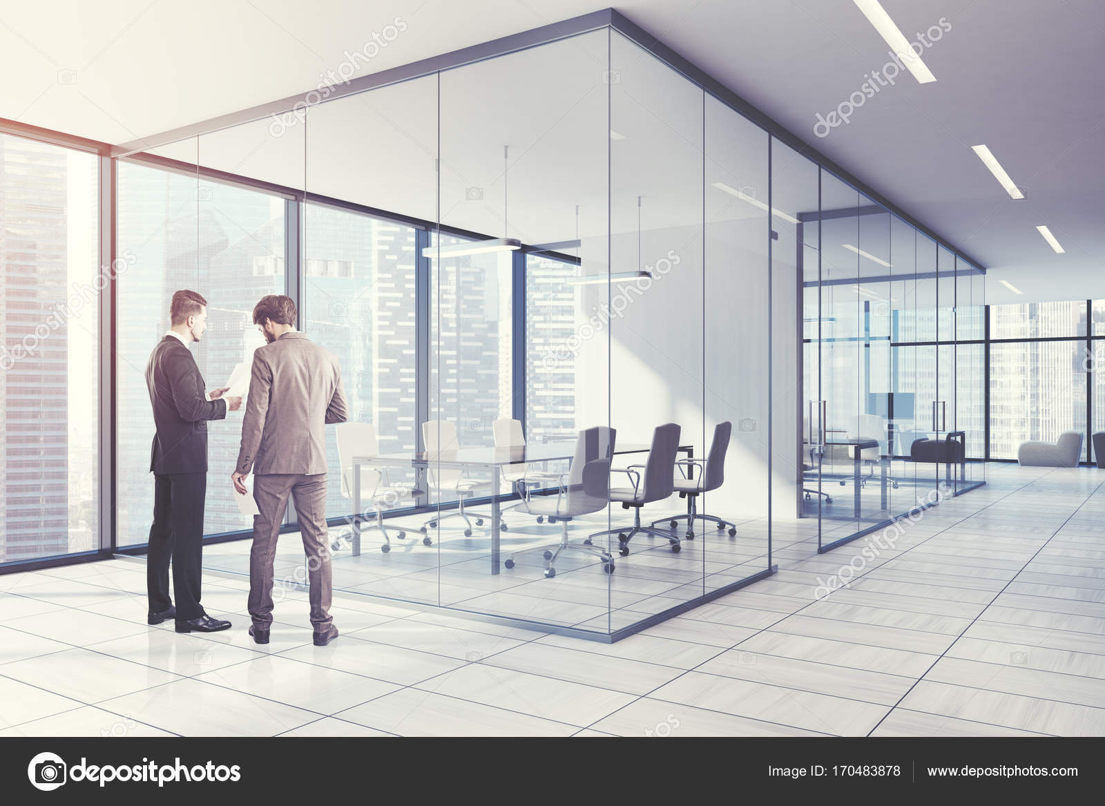 Corner Of A Glass Wall Meeting Room With Wooden Floor Panoramic Windows And Long Table White Armchairs Around It People