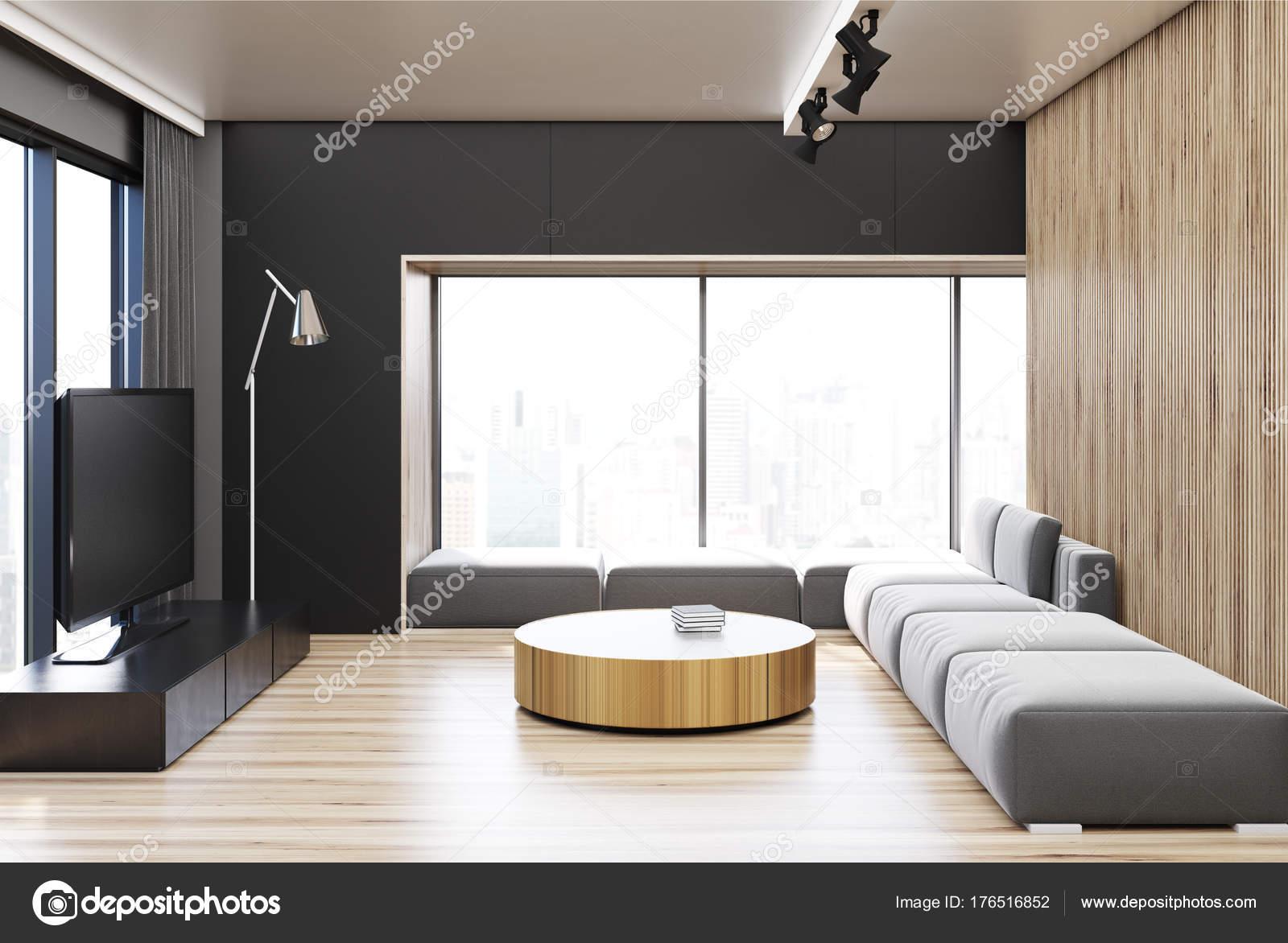 Zwart en houten woonkamer ronde tafel u stockfoto