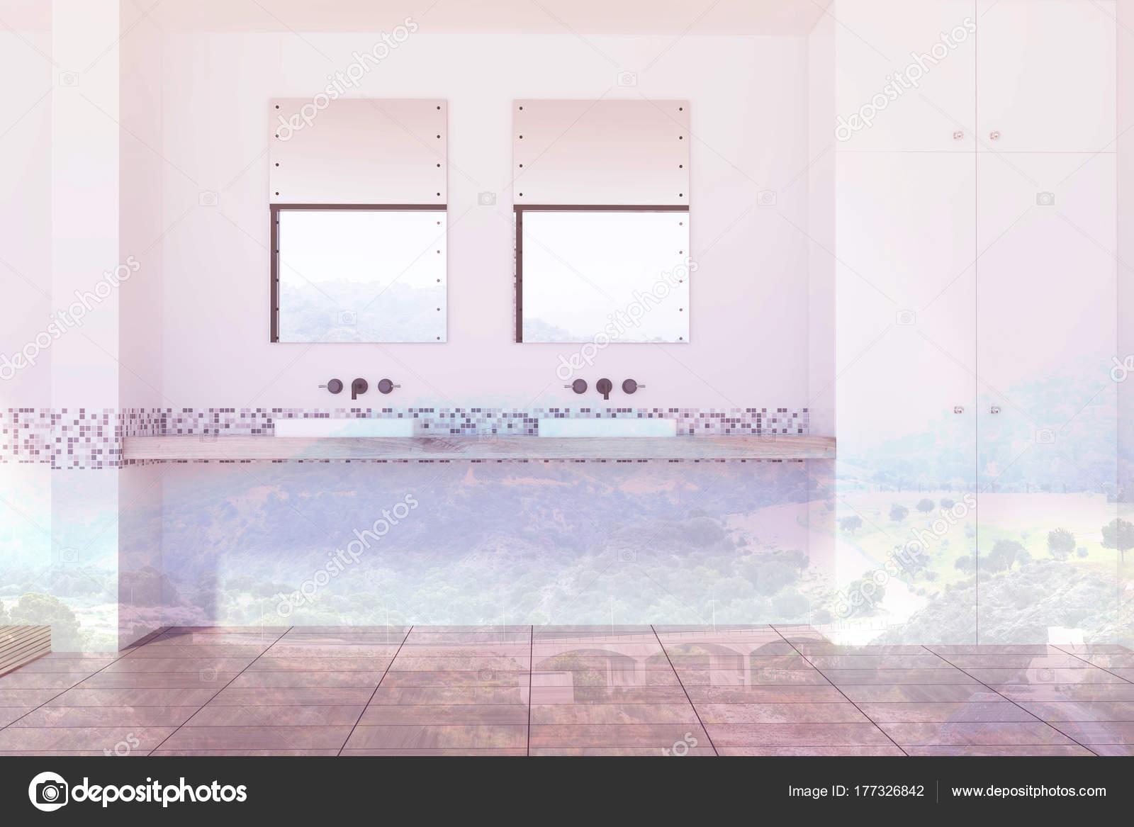 Bagno rivestito di piastrelle bianca e grigia lavelli tonica