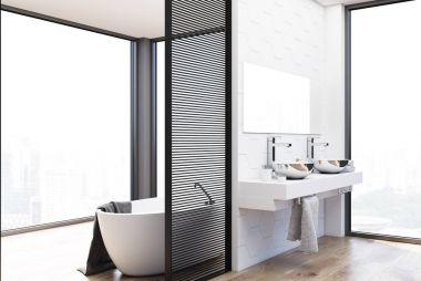 Hexagon tile bathroom, double sink and tub