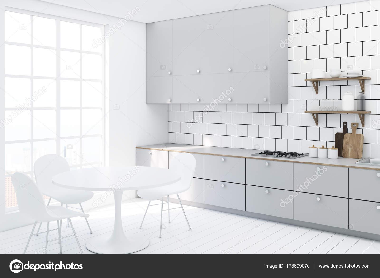 Con piastrelle bianche e lato controsoffitto cucina grigio u foto