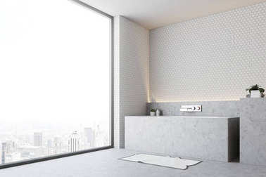 White bathroom gray tub close up side