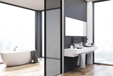 Gray hexagon tile bathroom, double sink and tub