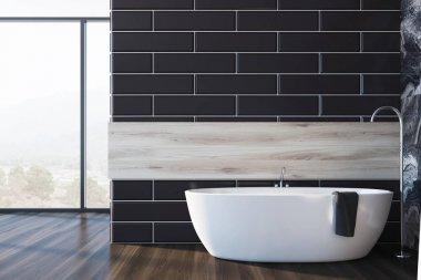 Black brick and wooden bathroom