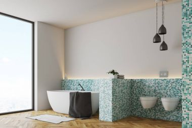 Green tile bathroom and toilet side