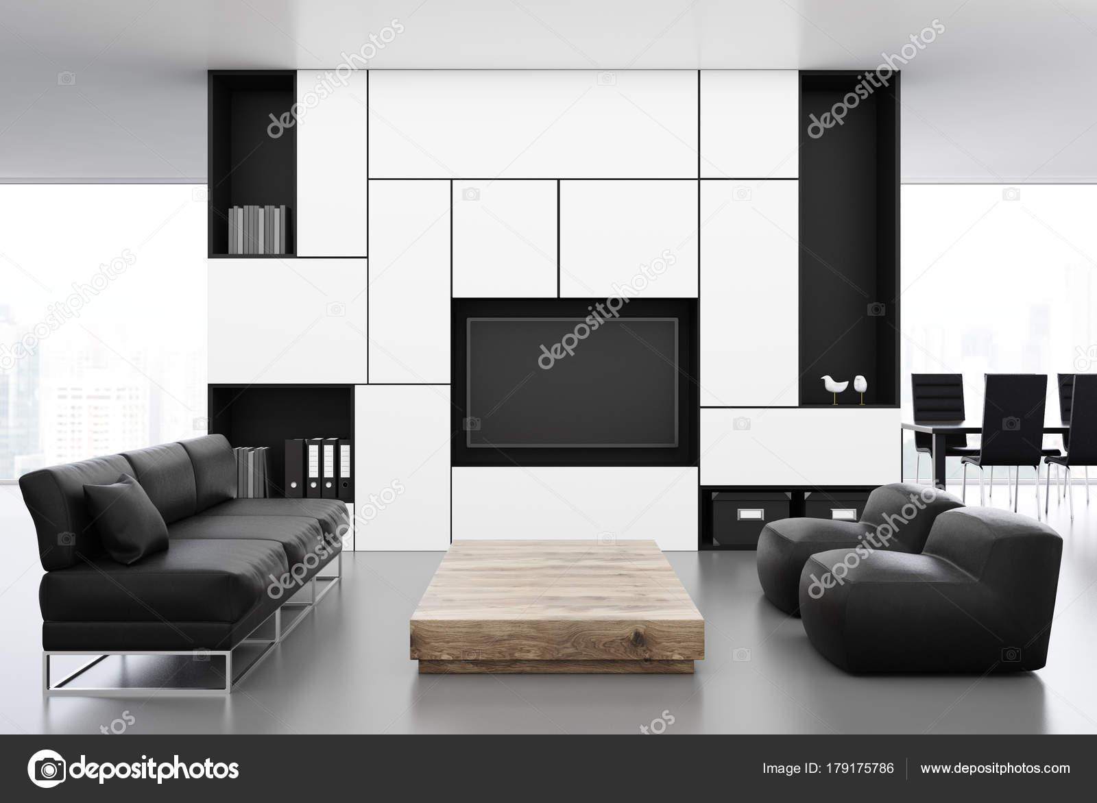 Divano Nero E Bianco : Salone bianco con un fronte divano nero u foto stock