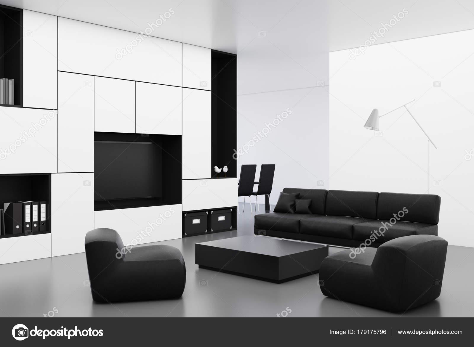 Divano Nero E Bianco : Angolo bianco soggiorno con un divano nero u foto stock