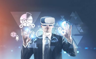 Businessman in VR glasses, HUD tirangles