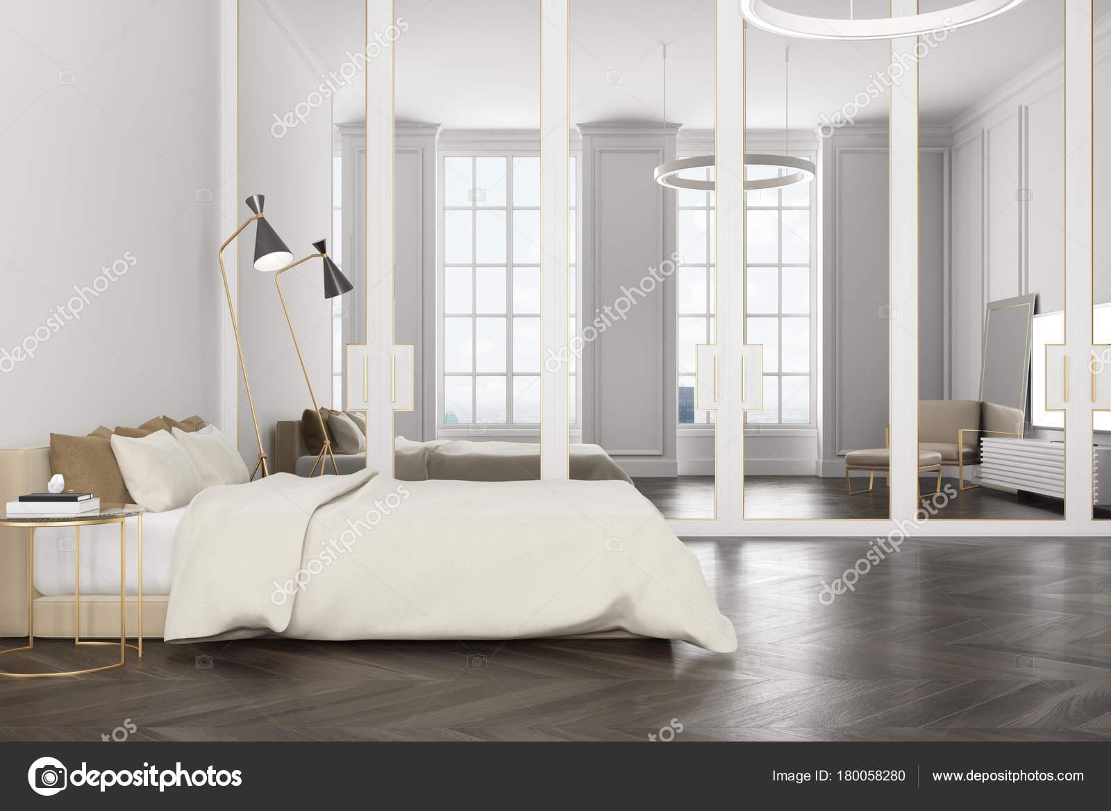 https://st3.depositphotos.com/2673929/18005/i/1600/depositphotos_180058280-stock-photo-white-bedroom-interior-a-tv.jpg
