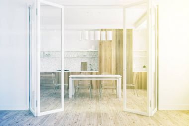 White dining room, glass door toned