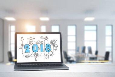 2018 start up sketch on laptop screen in office