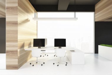 Black ceiling office interior, computer screens