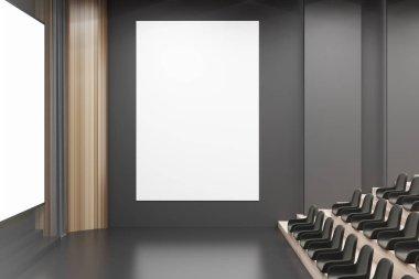 Cinema interior, black chairs, poster