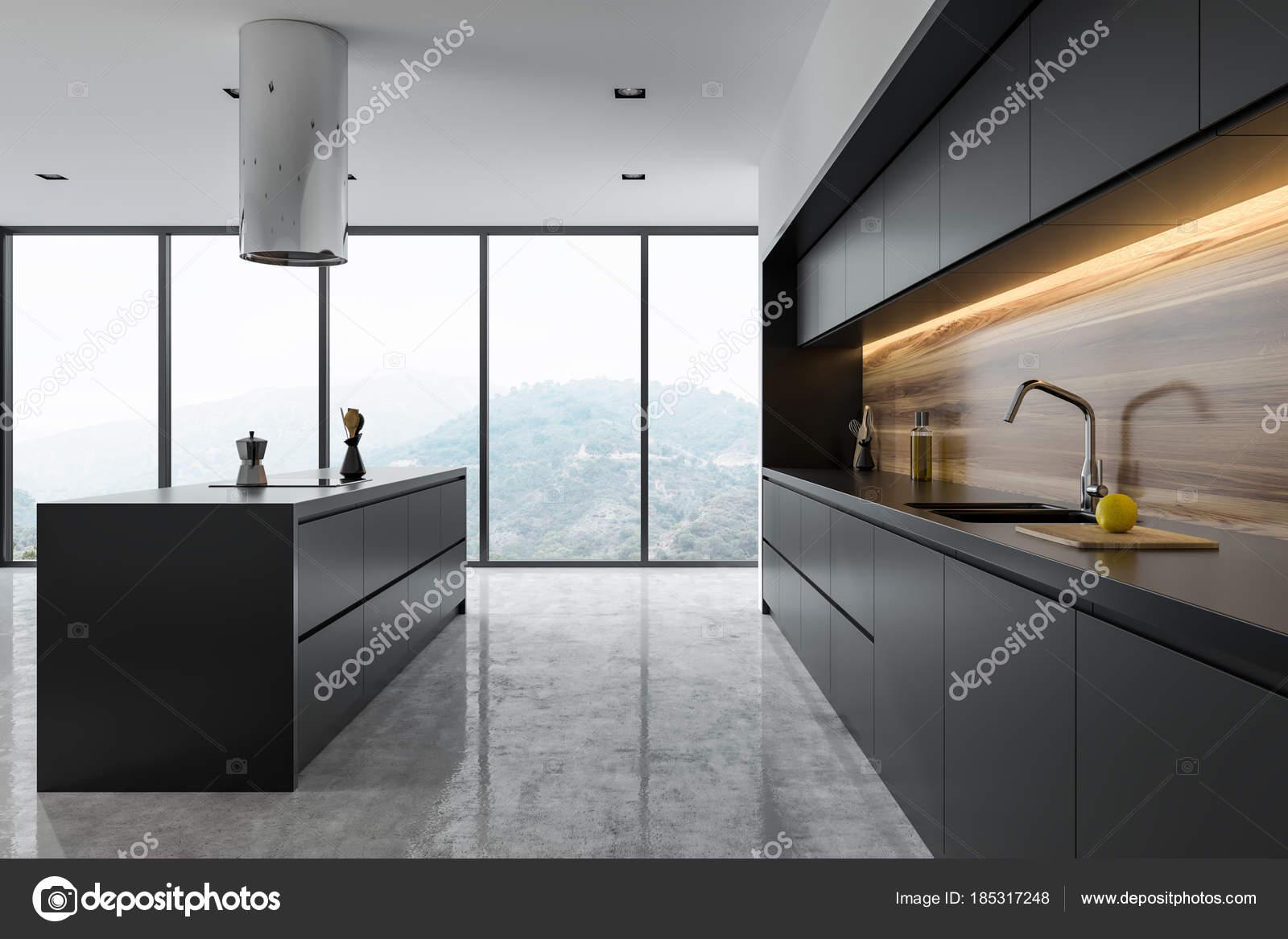 Vista Laterale Di Una Cucina In Legno E Nera Foto Stock