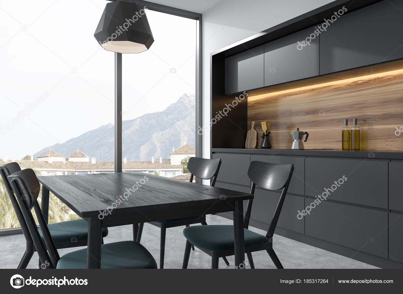 Mesa de comedor gris oscuro en un rincón de la cocina gris — Fotos ...