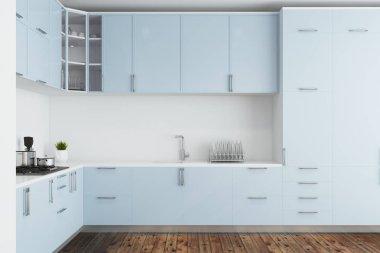 White kitchen, blue countertops