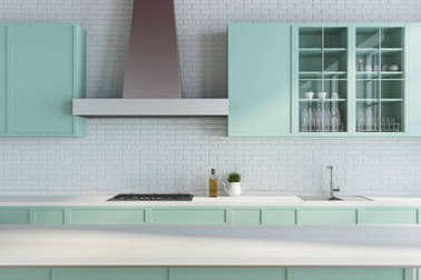 Modern white kitchen, green countertops close up