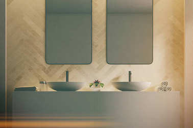 Double sink in a light wood bathroom toned