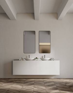 White sink vanity unit in a white bathroom, double