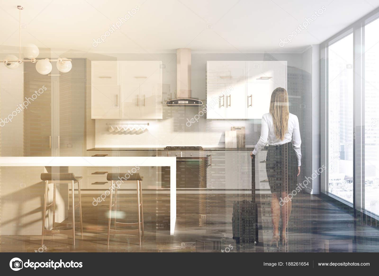 https://st3.depositphotos.com/2673929/18826/i/1600/depositphotos_188261654-stock-photo-gray-kitchen-white-and-gray.jpg