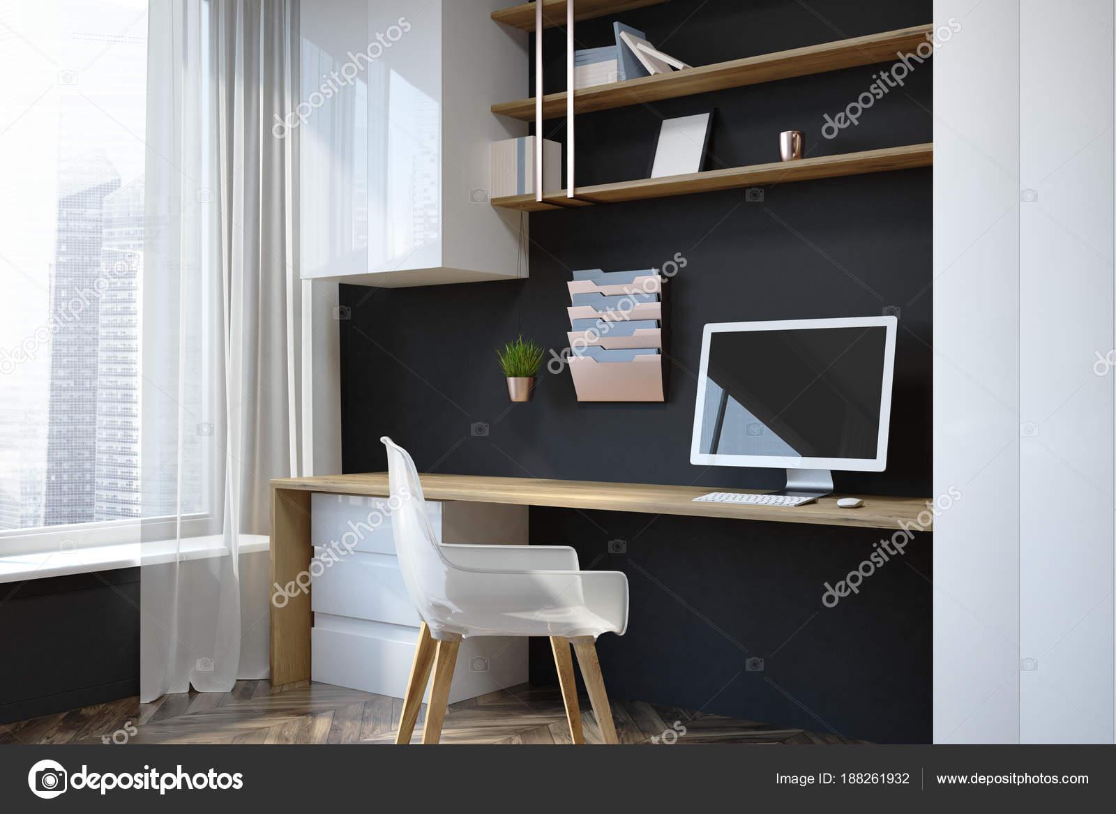 Coin de bureau noir à la maison au travail u photographie