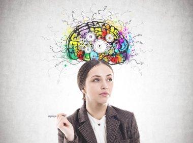 Pensive businesswoman with a pen, cog brain