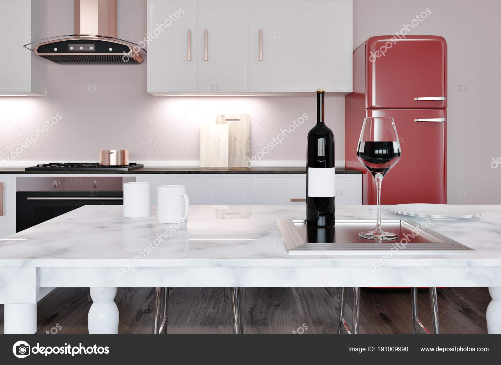 White marble kitchen island red fridge stock photo