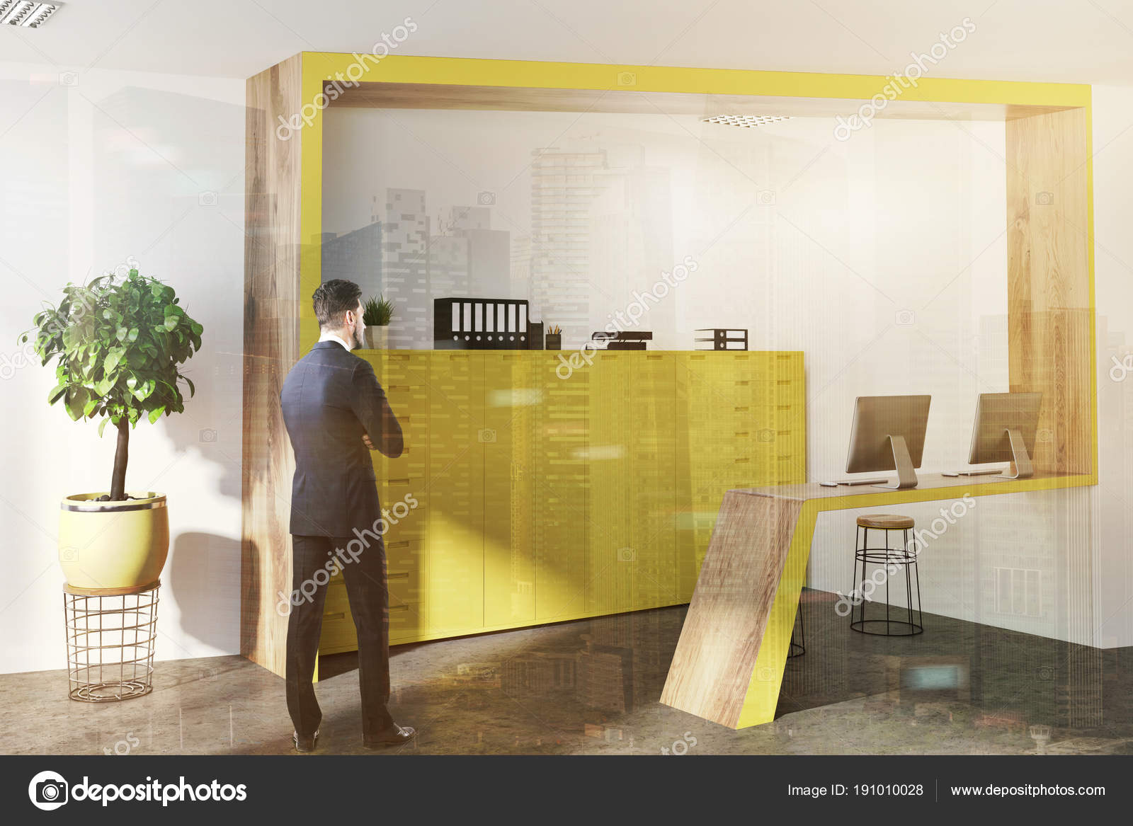 Angle de réception bureau jaune et en bois homme u photographie