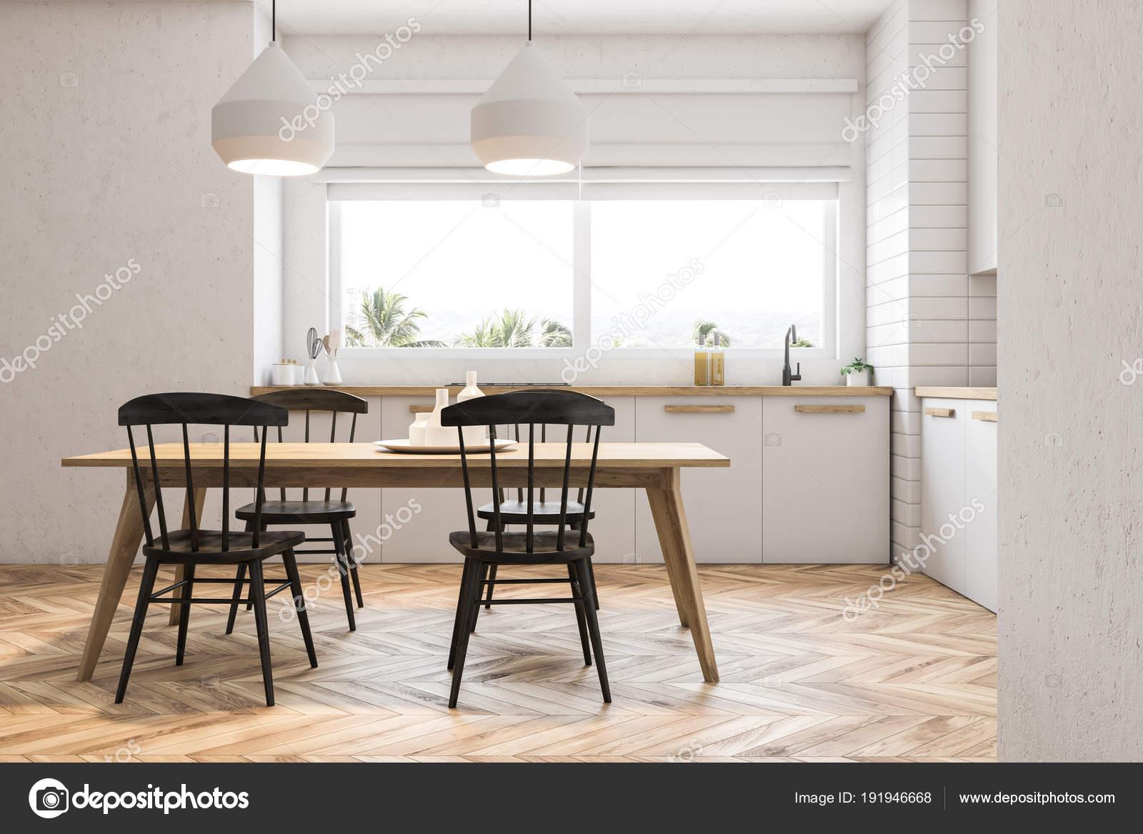 Witte Tafel Zwarte Stoelen.Zijaanzicht Van Witte Keuken En Eetkamer Stockfoto