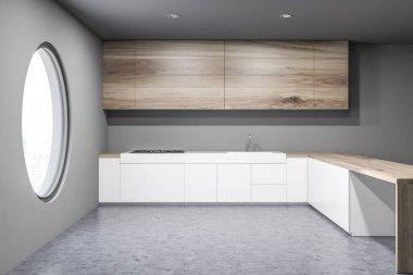 Gray round window kitchen interior, countertops