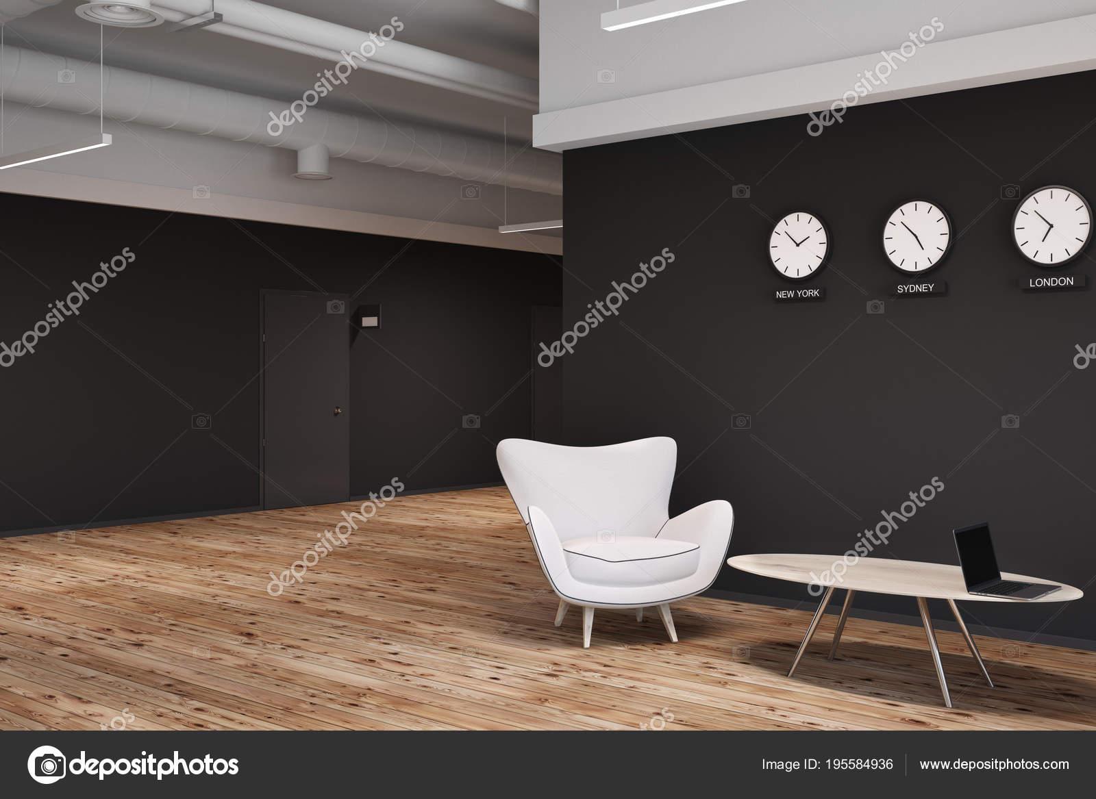 Mur noir bureau hall d accueil avec fauteuils et horloges