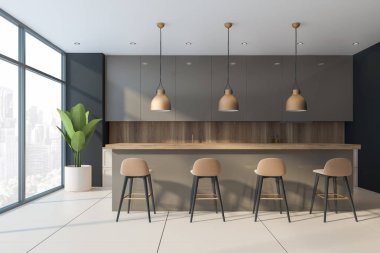 Long beige bar in spacious kitchen