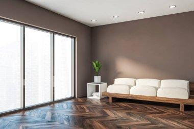 Minimalistic brown living room corner with sofa