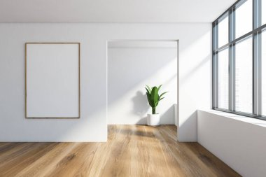 Interior of empty white room with wooden floor, window with blurry cityscape and vertical mock up poster frame hanging near doorway. Potted plant in background. 3d rendering