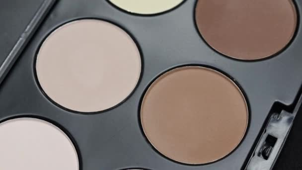 Rotating professional makeup eyeshadow palette, close up