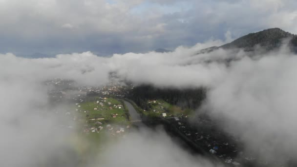 Aerial view drone footage of flowing fog waves on mountain  rain forest, Bird eye view footage over the clouds Amazing nature background with clouds and mountain peaks.