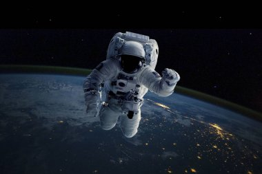 Astronaut in outer space. Background Earth. Elements of this image furnished by NASA