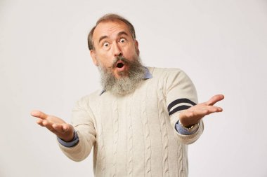 Portrait of mature man with beard looking at camera and surprised with something isolated on white background stock vector