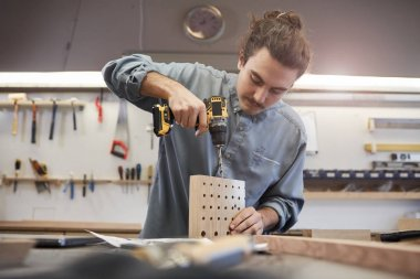 Man making details from wood