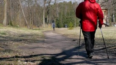 People do Nordic walking spring park