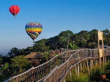 Hot air balloons on blue sky at Ban Doi Sa-ngo Chiangsaen