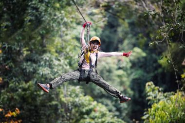 Woman Tourist Wearing Casual Clothing On Zip Line