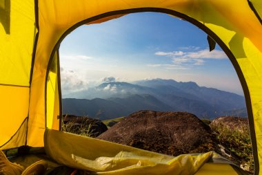 Mountain view in the morning looking through the tent to the front.  ; Mulayit Taung,Moei Wadi,Myanmar.